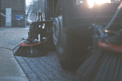 Close up of a sweeper truck